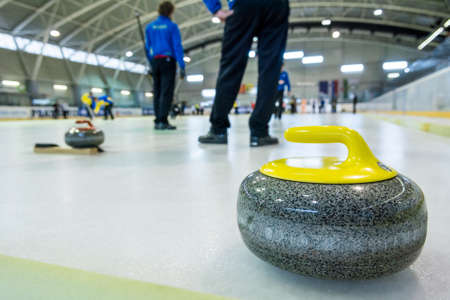 Photo pour Curling stone on a game sheet. - image libre de droit