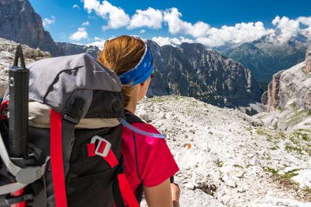 Photo for Female climbing enjoying spectacular mountain view. - Royalty Free Image