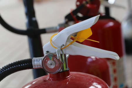 Photo pour closeup of Fire extinguisher lever - image libre de droit