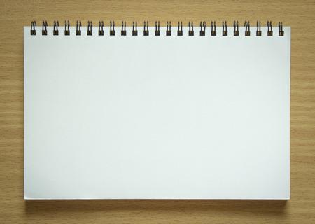 Photo pour blank spiral notepad on wood background - image libre de droit