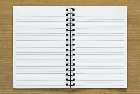 Foto de open spiral notebook on wood background - Imagen libre de derechos