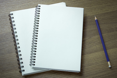 Photo for blank spiral notebook and pencil on dark wood background - Royalty Free Image
