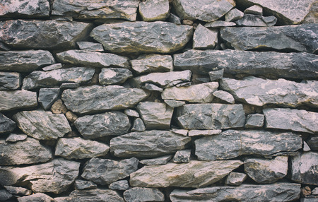 Foto de Stone wall texture or background - Vintage Filter - Imagen libre de derechos