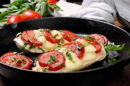 Foto de Langet from chicken breast with tomato and mozzarella. A-la caprese. - Imagen libre de derechos