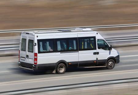 motor van goes on the country highway