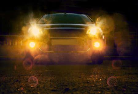 Foto de lights of modern car at night in city - Imagen libre de derechos