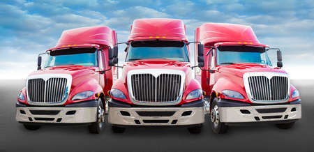 Photo for Three large red truck on the road - Royalty Free Image