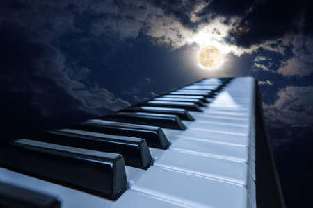 Photo for piano keys in moonlight cloudy night - Royalty Free Image