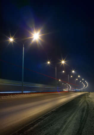 Photo for winter highway lit by street lights at night - Royalty Free Image