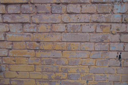 Photo for Weathered brick wall with remains of paint texture - Royalty Free Image