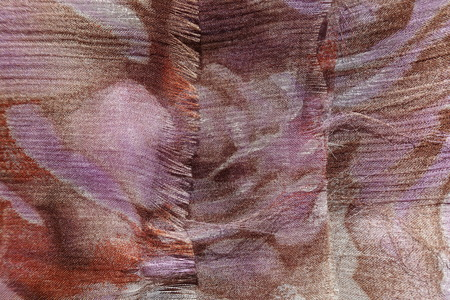 Photo for Unraveling edge of thin brown and mauve chiffon fabric - Royalty Free Image