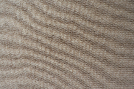 Photo pour Background - simple beige knitted fabric from above - image libre de droit