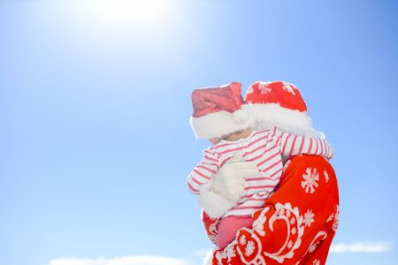Photo for Joyful Santa Claus holding giftbox in hands on blue light sky outdoors background - Royalty Free Image