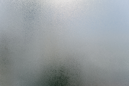 Foto de Window transparent blurred foggy glass with condensated water drops monochrome background. Vibrant freshness simplicity texture, season mood image - Imagen libre de derechos