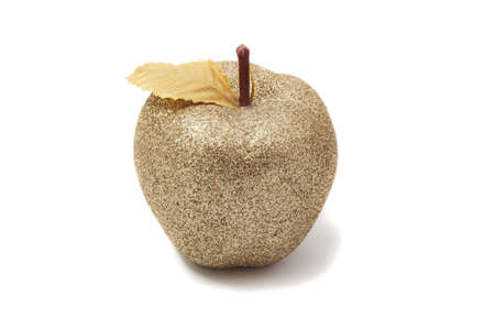 Golden apple shining on a white background