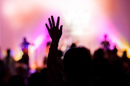 Photo pour christian music concert with raised hand - image libre de droit