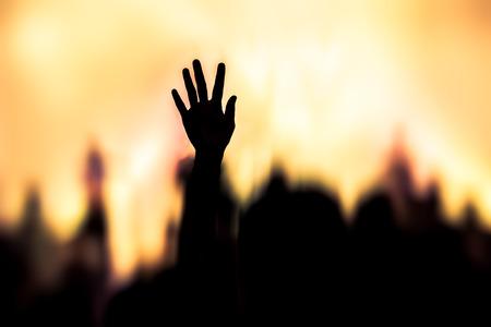 Foto de christian music concert with raised hand - Imagen libre de derechos