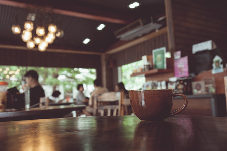 Photo for vintage tone of cup of coffee on table in Coffee shop blur background with bokeh image. - Royalty Free Image