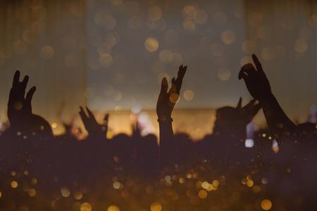 Photo pour Vintage tone of christian music concert with raised hand - image libre de droit