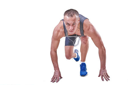 Photo for Handsome man at the start in sportswear isolated on white background for any purpose - Royalty Free Image