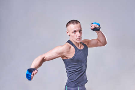 Photo pour Handsome athletic man strikes in gloves, for any purposes - image libre de droit