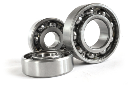 Photo pour Three close-up bearings on the white background. - image libre de droit