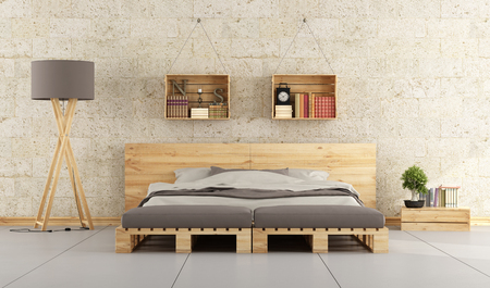 Foto de Modern bedroom with bed pallet on brick wall - Imagen libre de derechos