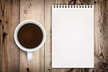 Sketchbook with coffee cup on wooden background