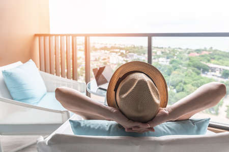 Photo pour Relaxation healthy living lifestyle summer holiday vacation of freelancer woman take it easy resting in comfort chair in resort hotel balcony having peace of mind and self health quality balance - image libre de droit