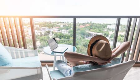 Photo pour life-work balance, relaxation healthy quality living lifestyle in summer holiday vacation of freelancer woman take it easy resting in resort hotel balcony having peace of mind - image libre de droit