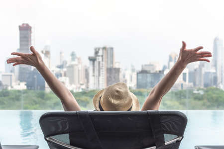 Photo pour Life celebration relaxation holiday travel vacation of business woman take it easy happily resting at swimming pool in luxury hotel with park and city view and summer sunny sky outdoor - image libre de droit