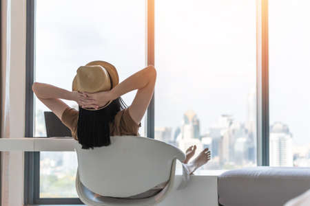 Photo pour Work and travel lifestyle relaxation and healthy work-life balance with young Asian working woman take it easy resting in comfort luxurious hotel guest room with peace of mind - image libre de droit