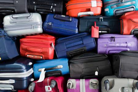 Foto de Suitcases multicolor stacked for transport one above the other - Imagen libre de derechos