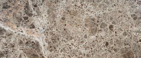 Foto de Beautiful brown marble surface with gravel chaotic texture - Imagen libre de derechos