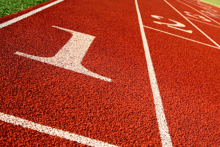 A shot of a running track and field start line