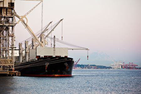 A shot of a shipping port with a ship loading or unloading shipment