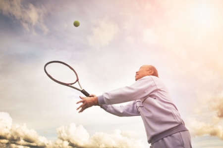 Photo pour A shot of a senior asian man playing tennis - image libre de droit