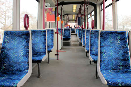 Empty wagon of a metro train with blue seats
