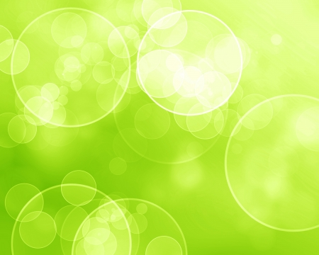 Green and fresh background with soft bokeh effects and white overlapping circles