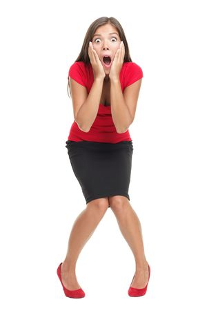 Shocked and surprised businesswoman isolated in full length. Beautiful mixed race caucasian / chinese young woman standing with open mouth holding her head in surprise. Isolated on white background.