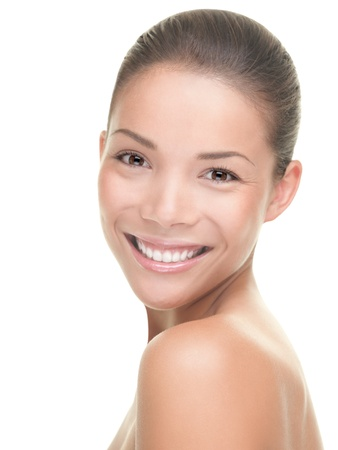 Woman Beauty. Portrait of young smiling woman isolated on white background. Mixed race Asian / Caucasian model.
