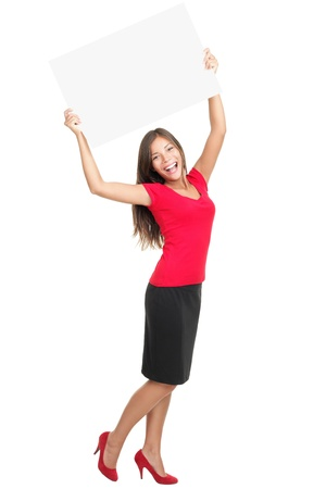 Photo for copyspace woman happy holding blank sign above her head. Beautiful young excited woman in red isolated in full length on white background. - Royalty Free Image