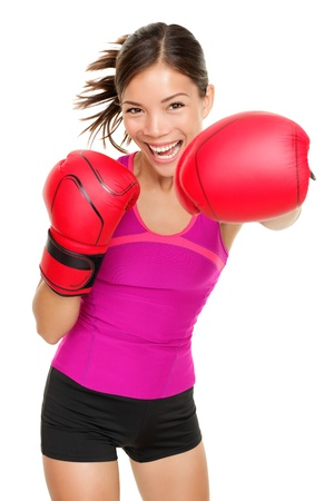 Boxer - fitness woman boxing wearing boxing gloves. Fitness boxing instructor punching fun and fresh towards camera. Beautiful mixed race Asian / Caucasian fitness girl isolated on white background.