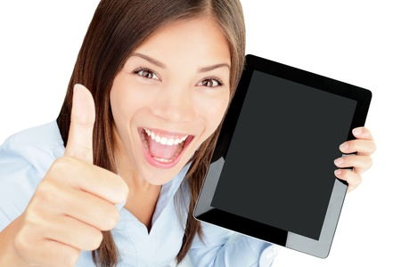 Tablet computer woman happy excited showing touch pad screen and thumbs up  Beautiful winning mixed race Asian Chinese   Caucasian female model