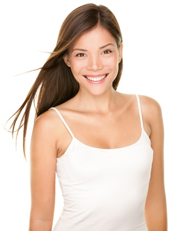 Photo for Portrait of beautiful young woman  Beauty portrait of gorgeous fresh smilng happy multi-racial Asian Chinese   Caucasian girl smiling cheerful in white tank top isolated on white background  - Royalty Free Image