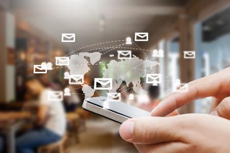 Foto de closeup of man hand with smartphone show social network,network and comunication concept - Imagen libre de derechos