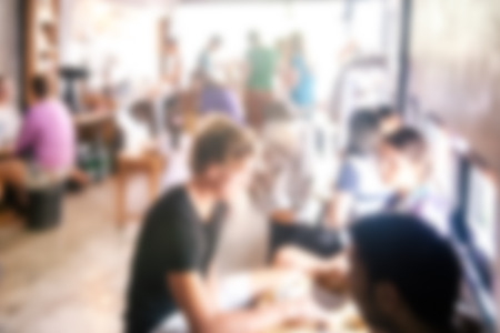 Photo pour blurred background of talking people in coffee cafe - image libre de droit