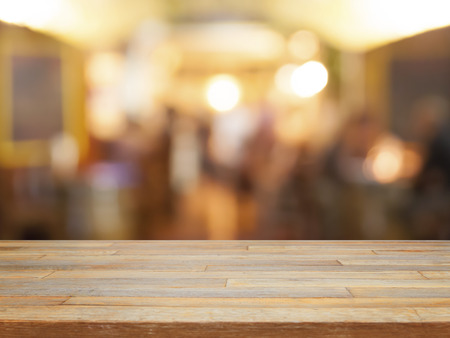 Photo pour Empty wooden table and blurred cafe background product display - image libre de droit