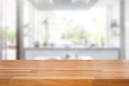 Foto de Empty wooden table and blurred kitchen background, product montage display - Imagen libre de derechos
