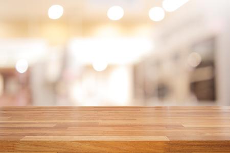 Foto de Empty wooden table and interior background, product display,blurred store with bokeh - Imagen libre de derechos
